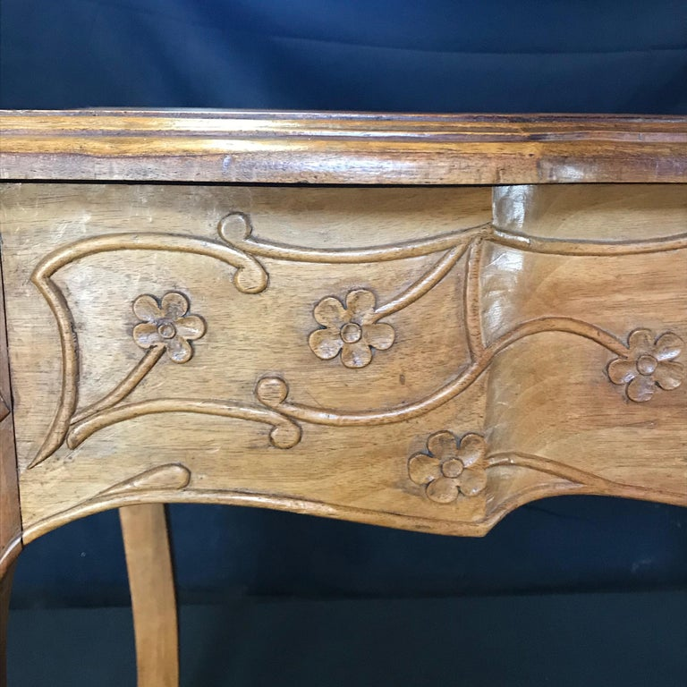 19th century country French Louis XV carved side table or desk. Can also be used as a game table. Hand carved floral and acanthus leaf artwork on the sides and cabriole legs. Gorgeous inset table top.  Measures: Apron height 21.75 #3408.
