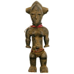 Carved African Baule Style Female Figure Sculpture