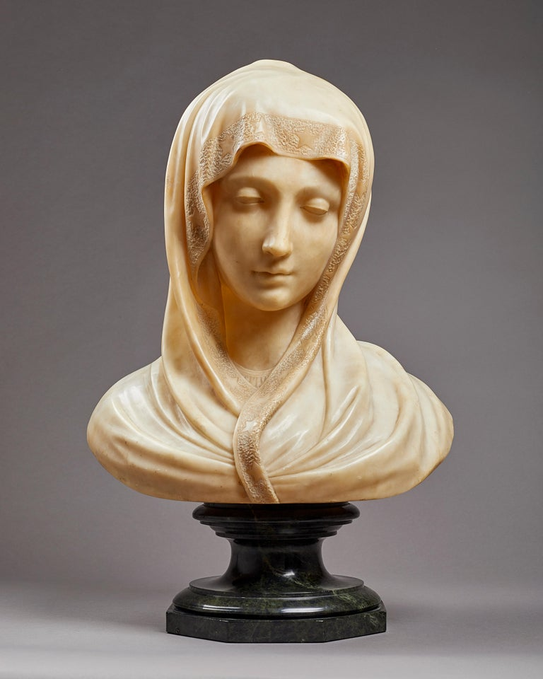 Bust of the Madonna as the 'Lady of Our Sorrows' (Mater Dolorosa) Italian, possibly Florence, late 19th century Alabaster, on a separate green serpentine socle Height: 40 cm. / 15 ¾ inches , overall 50 cm. / 19 ½ inches  In the Renaissance and