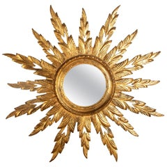 Carved and Gilt Wooden Sunburst Mirror