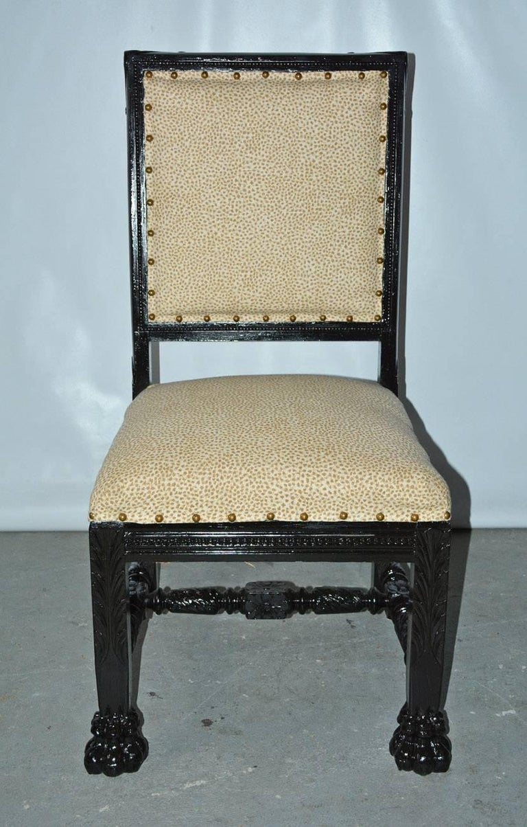 19th century Gothic Renaissance style ebonized side chair with boldly carved paw feet, upholstered seat and back. Newly reupholstered with small animal print fabric.