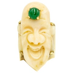 Carved Angel Skin Coral Smiling Buddha Face Gold Ring with Emerald Third Eye