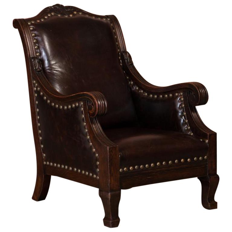 Carved antique danish oak arm or club chair with leather
