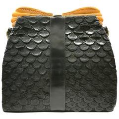 Carved Bakelite, exotic black leather handbag, by Salisbury's, English, 1930s