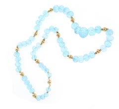 Carved Blue Topaz Necklace with Gold Beads