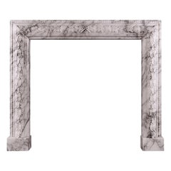 Carved Bolection Fireplace in Arabescato Marble