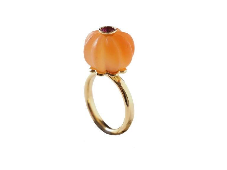 Carved  carnelian pumpkin shape with blu sapphire in the center 18 k brushed gold  gr 5,90. Size 14 eu. All Giulia Colussi jewelry is new and has never been previously owned or worn. Each item will arrive at your door beautifully gift wrapped in our