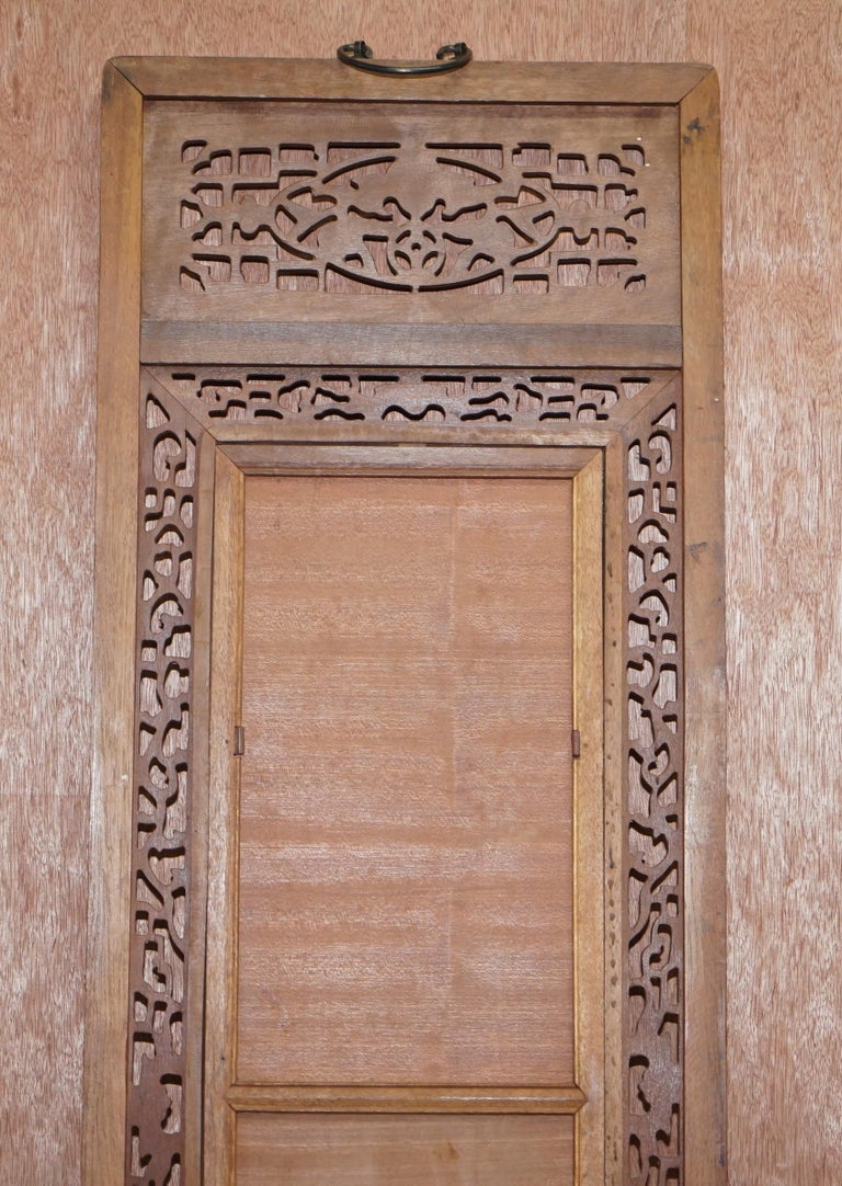 Round carved panel depicting doves