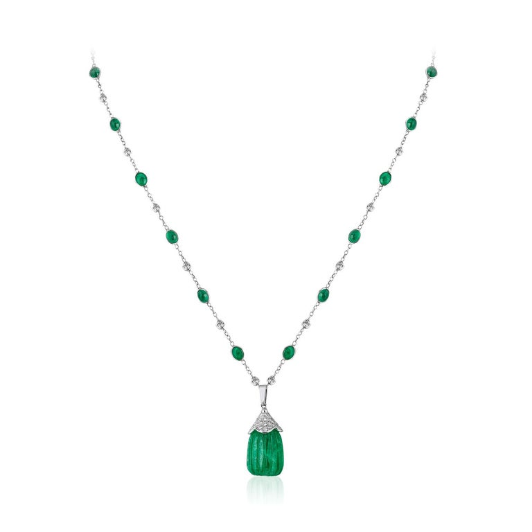 Carved Emerald Drop Pendant Emerald Cabochon and Diamond 18k Andreoli  This Andreoli pendant features a dazzling 42.95 carat carved Colombian emerald drop. The diamond by the yard contains 21.95 carat of oval emerald cabochons and the pendant is