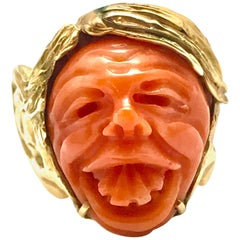 Carved Coral and Yellow Gold Goofy Face Ring