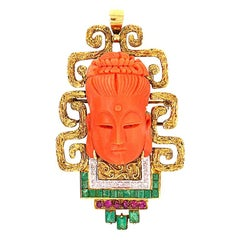 Carved Coral Buddha Pendant in 18k Gold Set with Diamonds, Emeralds and Rubies