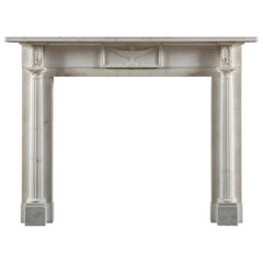 Carved Early 19th Century Regency Period Chimneypiece in Statuary White Marble