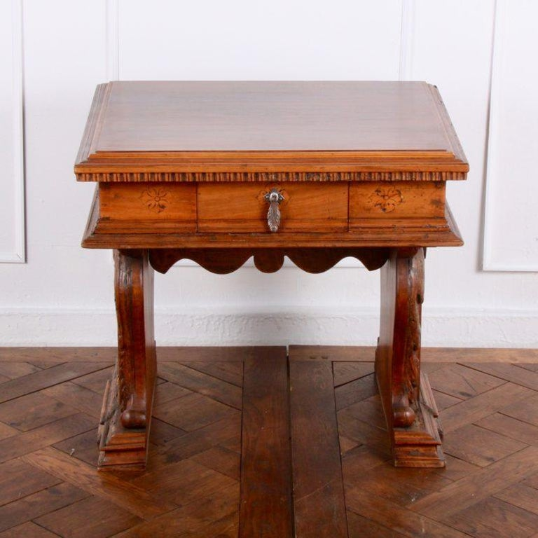 Highly carved side table with single drawer and delicate inlays along the sides, circa 1500. Clearly shown in photographs of the interior of the villa.   Measures: 26? wide x 23? deep x 23.5? tall.