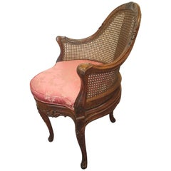 Carved Fruitwood French Cane Corner Chair