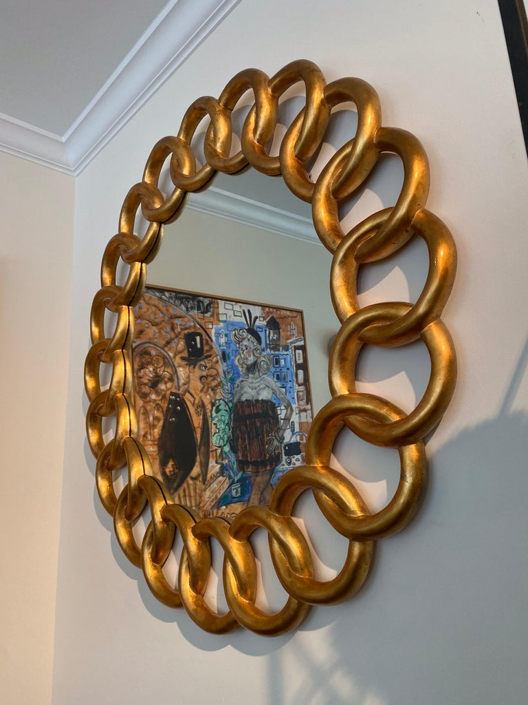 Heavy carved and gilded Pretzel design round mirror by Harrison & Gil.