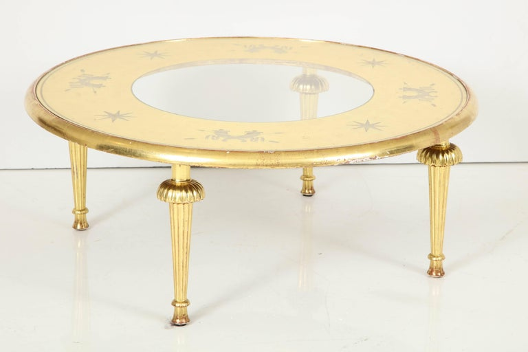 Carved giltwood and églomisé top coffee table attributed to Gio Ponti.