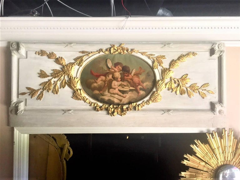 Louis XVI Carved Giltwood and Painted Boiserie Overdoor Frieze Panel with Cherubs Inset For Sale