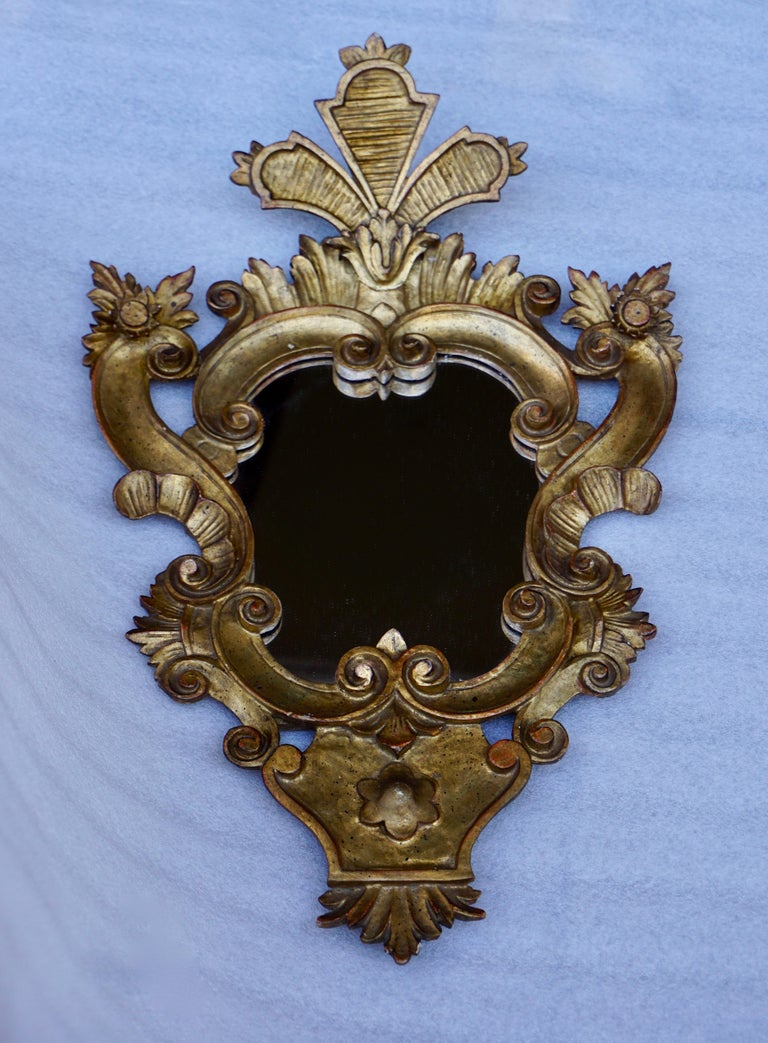 Beautiful Large Venetian Rococo style carved gilt wood mirror. Measures: Height 60 cm. Width 38 cm. Depth 10 cm.