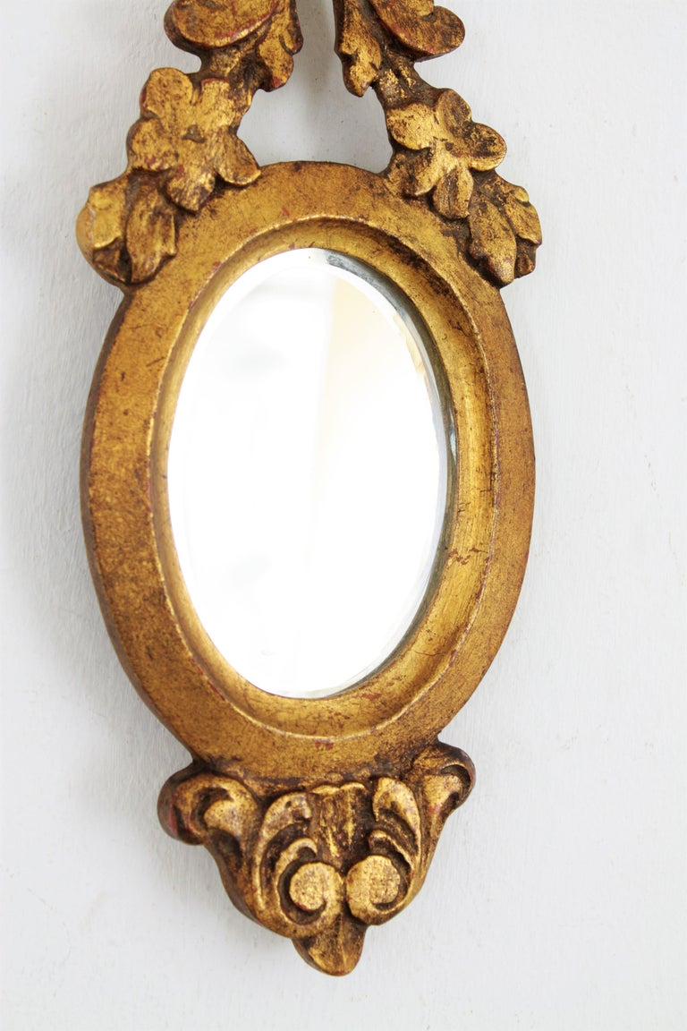 20th Century Carved Giltwood Renaissance Style Mini Sized Mirror with Crest, 1930s For Sale