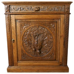 Carved Golden Oak Game Cupboard