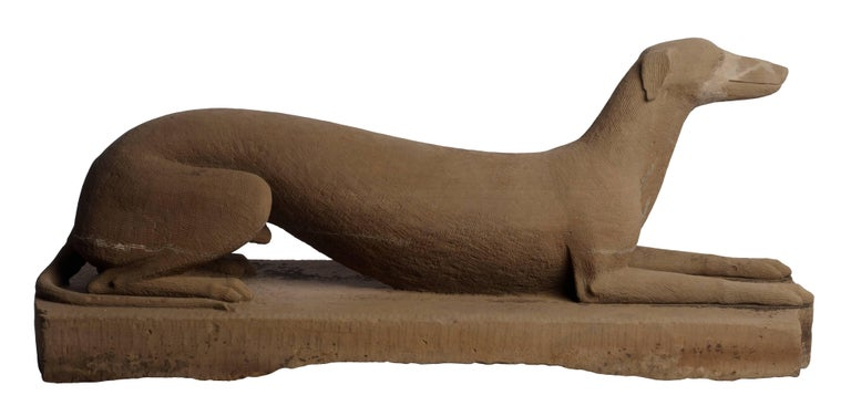 Sleek portrait of a Greyhound carved from sandstone in the mid-19th century. Descended in the Farmer family of Portsmouth, Ohio and believed to have been carved by an ancestor who arrived there from Virginia in the mid- 19th century. Originally