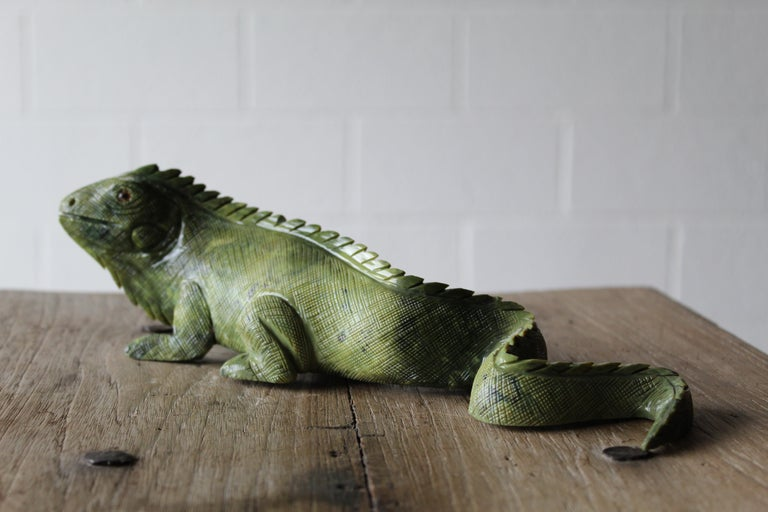 The most charming, carved green soapstone carving of an Iguana. Artist is unknown. The eyes are glass.