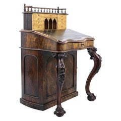 Carved Irish Rosewood and Leather Rise and Fall Davenport, circa 1850