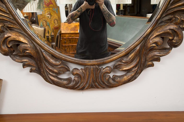 Hand-Painted Carved Italian Oval Burnished Pine Mirror For Sale