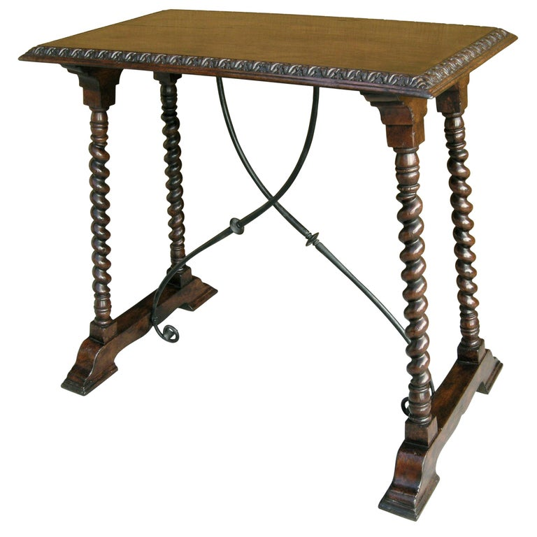 Carved Italian walnut and wrought iron Sorrento side table by Randy Esada  Item #: 9029 - Sorrento side table Finish: Distressed dark walnut and aged iron Dimensions: Top 32 W x 18.5 D Base 34 W x 21 D x 30.5 H 2 in stock, quantity order