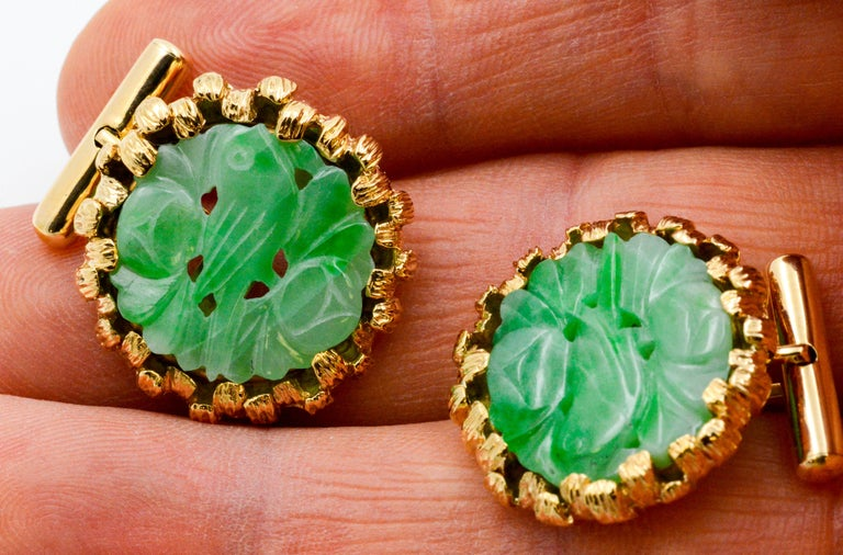 These vibrant jade disc cuff links with a bird design are perfect for a pop of color. Based on a Chinese belief, twin birds, like those within the jade cuff links, are messengers of good news. These cuff links are accented with 14K yellow gold