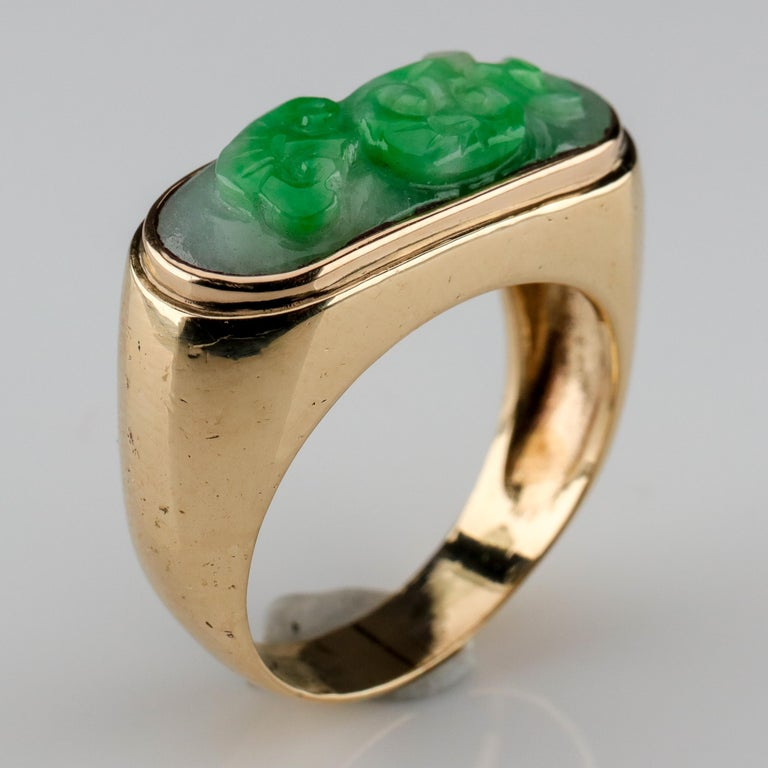 You've seen a jade saddle ring: a simple band of gold or silver that wraps around your finger with a bar of jade running West to East across the face. It's the classic jade ring. And this ring is a twist on that classic form: it's a carved jade