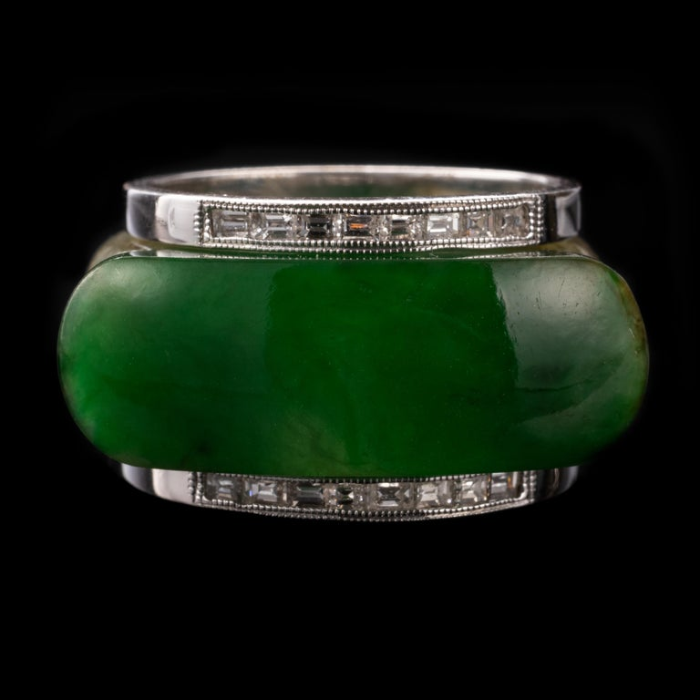 Hand-carved from a succulent slab of natural Burmese jadeite jade, this rather astonishing ring is among the most unique and extraordinary jade rings in my collection.  Jadeite with a humble body color of mottled greenish-brown has been gifted by