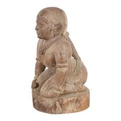 Carved Kneeling Figure