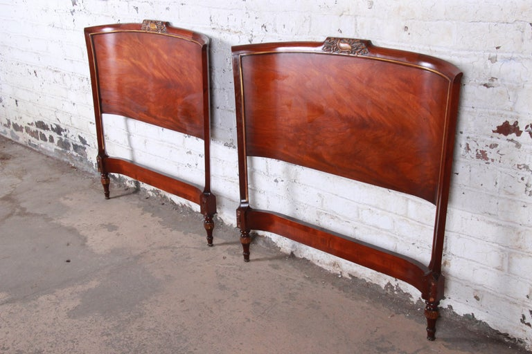 A gorgeous pair of carved mahogany twin headboards  By Irwin Furniture Co.  USA, circa 1940s  Measures: 42.13