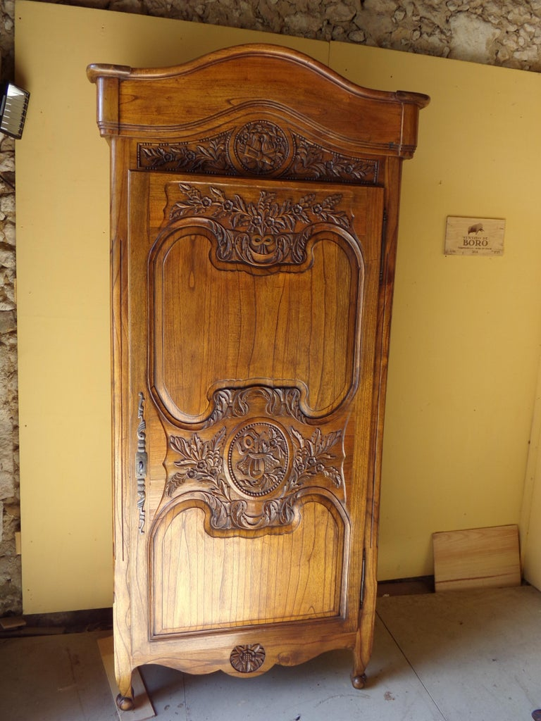 A beautiful and rare single door Fruitwood Bonnetiere/ Armoire circa 1850 in fine original condition. Bonnetiere were used in the entrance hall to hold visitors hats,