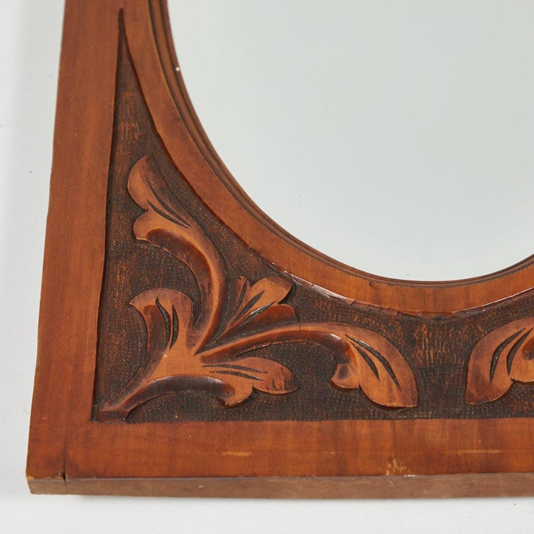 English Carved Mirror with Oval Beveled Glass For Sale