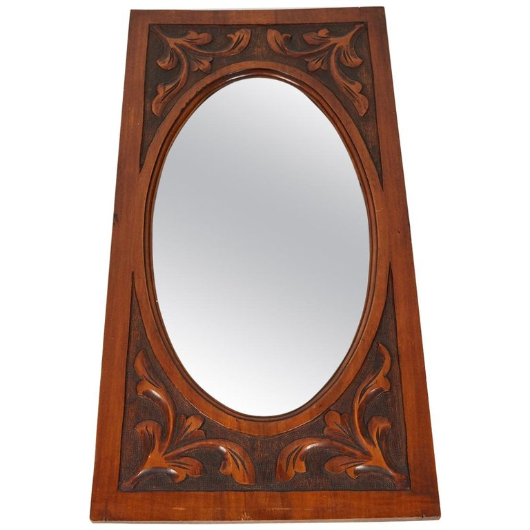 Carved Mirror with Oval Beveled Glass For Sale