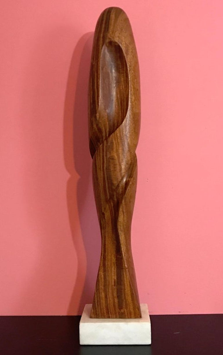 Carved modern wood sculpture, attributed to Henry Moretti, inscribed with cypher, on a 5.5