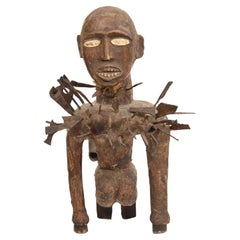 Carved Nkisi N'kondi Power Statue with Inserted Metal Objects and Animal Skin