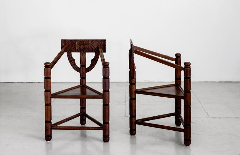 Wonderful pair of solid oak Monk chairs from Sweden. Ornately carved with Native style detailing. Stunning from all angles.