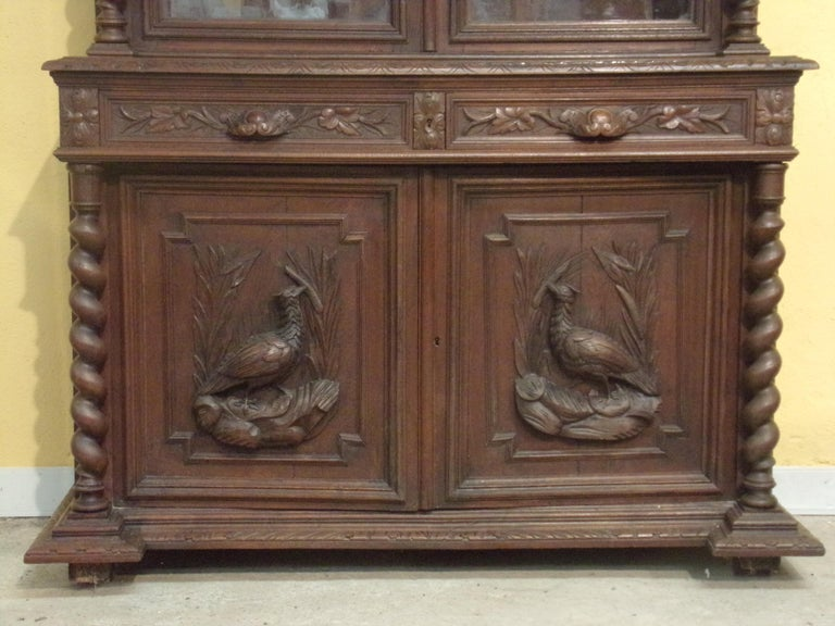 Good quality hand carved oak bookcase / Gun cupboard in the Louis XIII style C1890 - This piece can be sold with fittings to hold up to 6 guns at no extra charge - see our photographs of a similar piece which has been converted. Two glazed upper