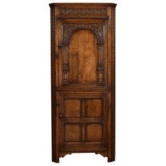 Carved Oak Corner Cupboard
