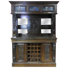 Carved Oak Figural Renaissance Style Stained Glass Dry Back Bar Wine Rack