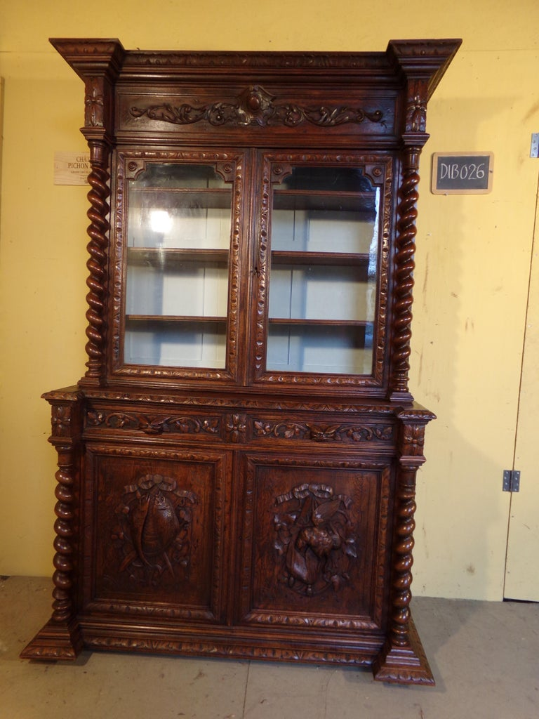 A good black forest style hand carved oak bookcase or gun cabinet circa 1880. This piece is presently set up as a book case however if you wish to use it as a gun cabinet we will convert it to hold 6-8 guns at no extra charge. Please note the last