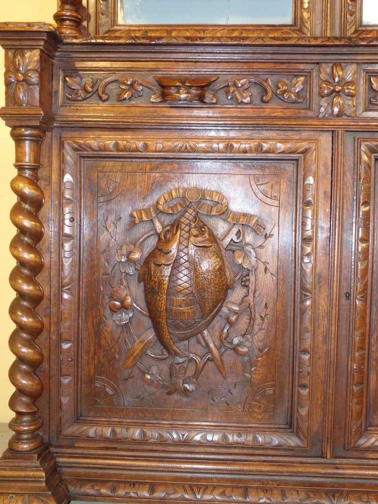 Late 19th Century Carved Oak Hunts Bookcase Gun Cupboard, circa 1880 For Sale