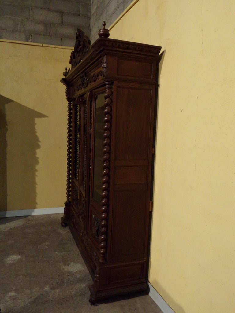 Superb hand carved oak bookcase in the Louis XIII style circa 1870 this impressive bookcase will be the focal piece of any room in which it is placed. Having three glazed doors enclosing fully adjustable shelves with three drawers below this