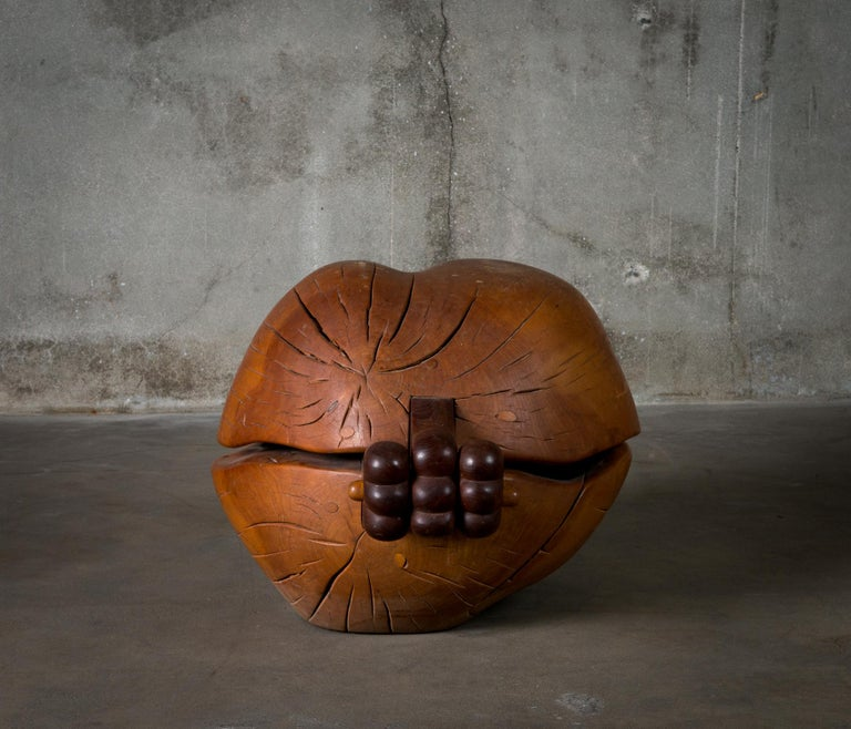 A carved wood container with carved wood oblong object within, by Jon Brooks (b.1944).