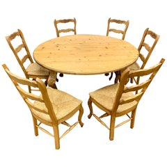 Carved Pine Farm Table and Six Matching Chairs Round Farmhouse Dining Set