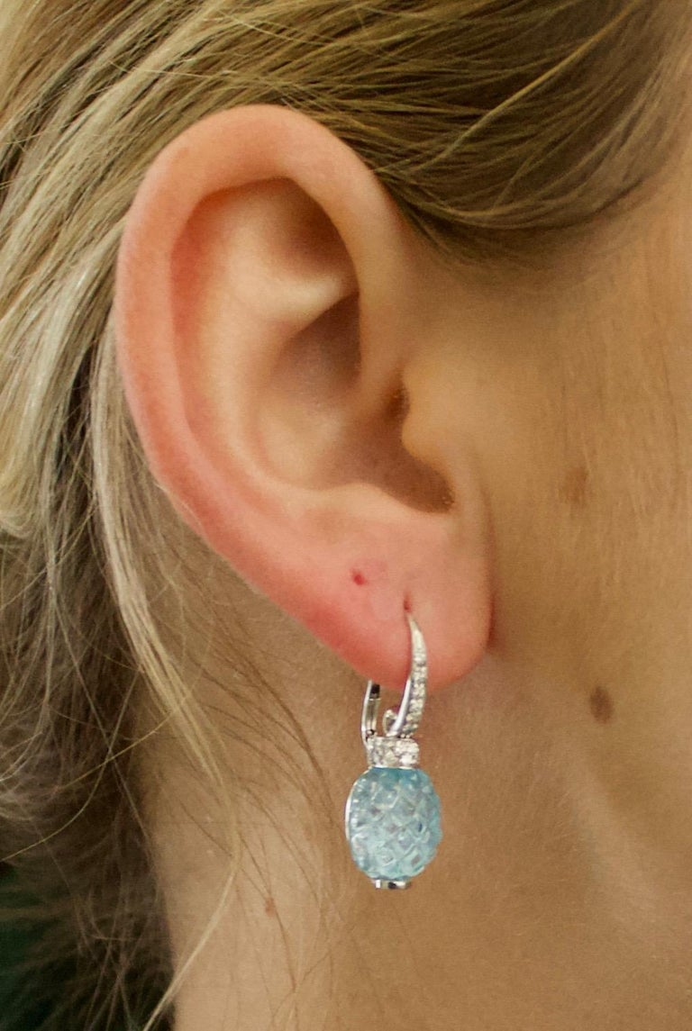 Carved Pineapple Blue Topaz and Diamond Earrings in 18k What Gold Two Carved Pineapple Blue Topaz Weighing 14.00 Carats Approximately Thirty Eight Round Brilliant Cut Diamonds Weighing .25 Carats Approximately  A Must Have For Blue Pineapple