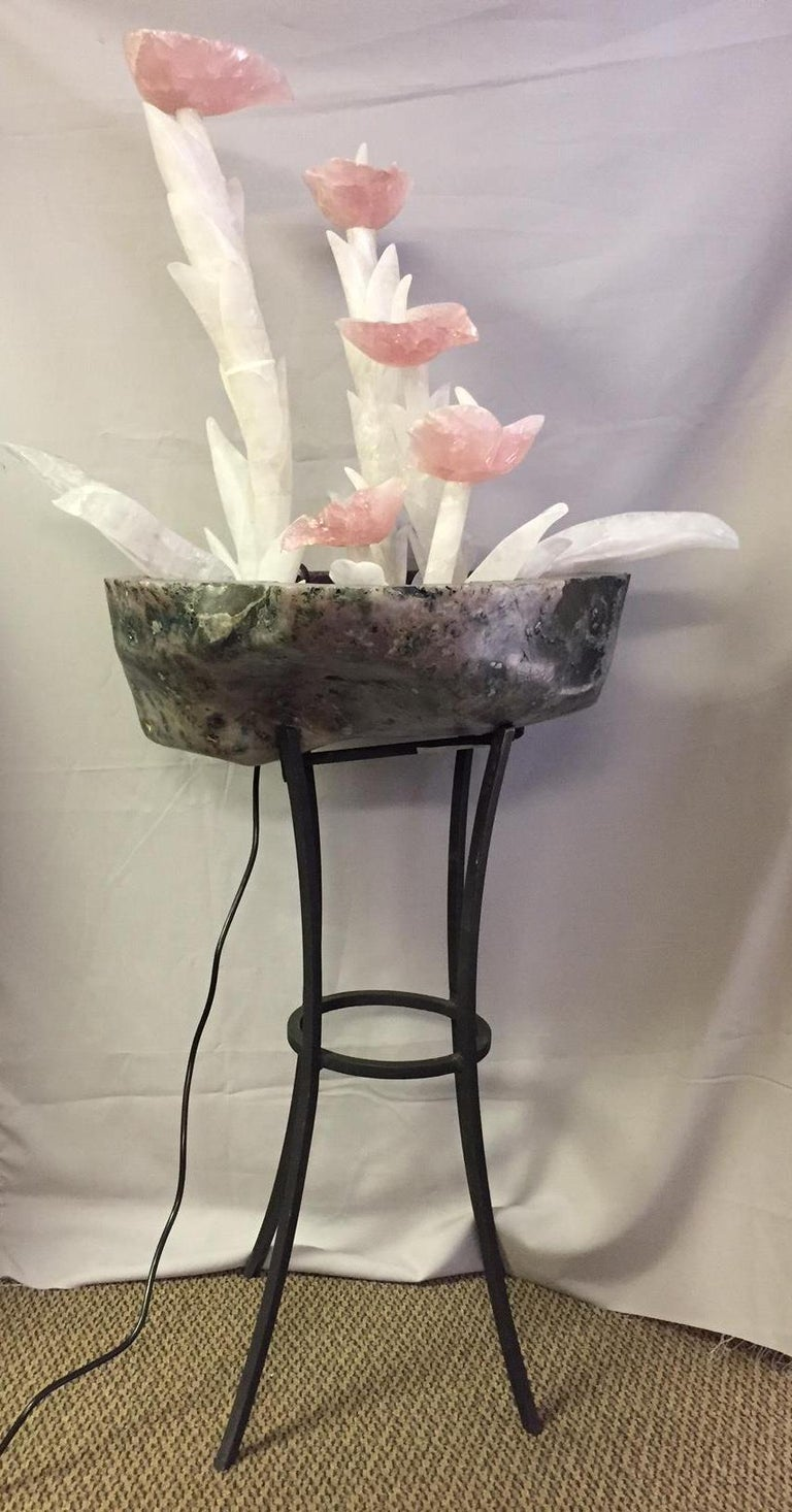 One-of-a-kind stunning hand-carved and hand-polished Rock Crystal, Rose Quartz and Amethyst Quartz fountain.  The beautifully hand-carved Rose Quartz flower pedals over gradually carved Rock Crystal stems with foliage, all five flowers and